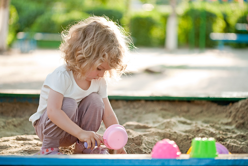 Image of Child playing in a sandpit
