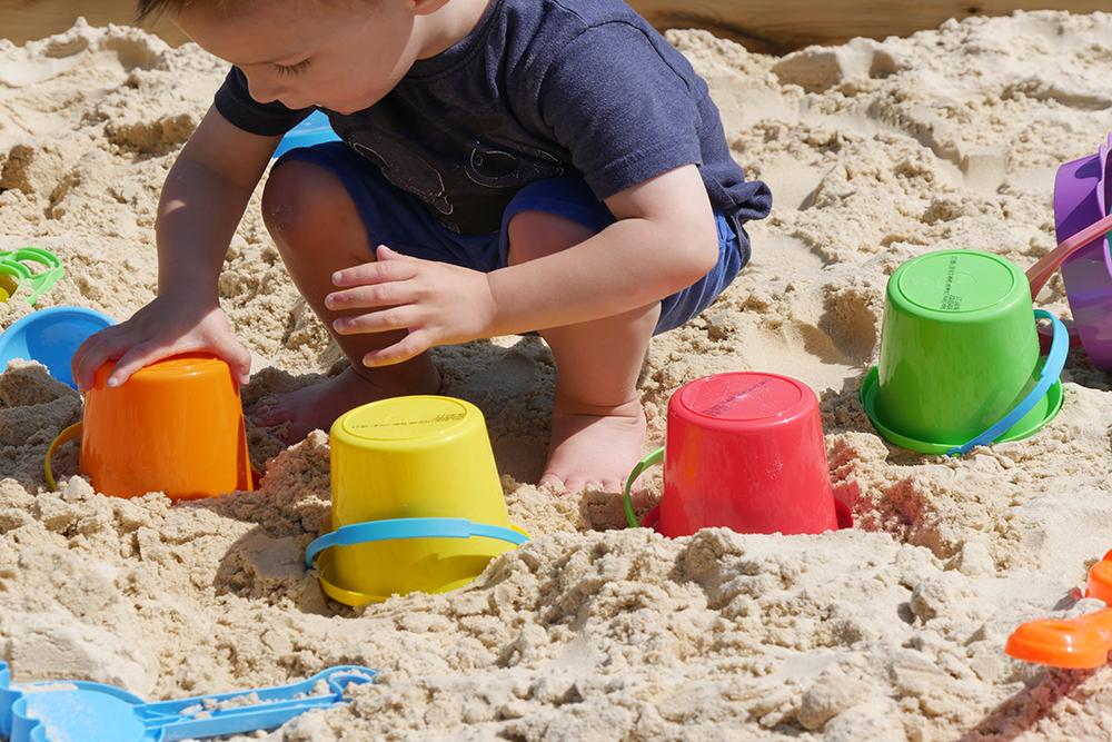 Kids enjoying playing in a sandpit